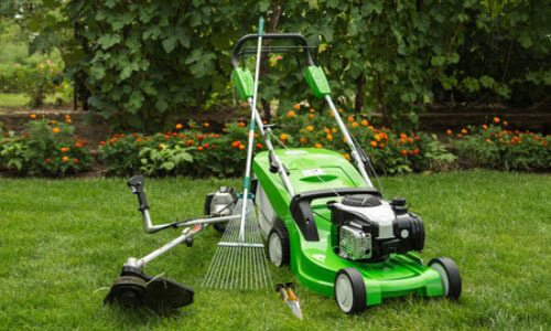 lawnmower and different gardening tools