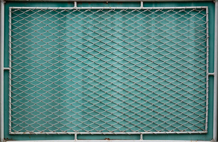 Covered chain link fence