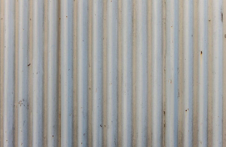 Galvanized corrugated metal sheet privacy fence